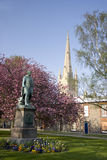 Norwich Cathedral in spring. The Norman style Norwich Cathedral with Wellington statue in spring royalty free stock photo