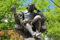 NORWICH, UK - JUNE 4, 2017: The statue of Sir Thomas Browne by sculptor Henry Alfred Pegram with a colorful background Stock Photos