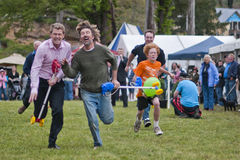 By a nose. MARYSVILLE, VICTORIA, AUSTRALIA - November 2: Two men compete for first place in a hobby horse race at the Marysville Sparkling Wine Festival stock photos