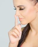 Nose. Close-up face of cute woman supporting nose by finger royalty free stock images