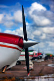 The nose of the aircraft with a propeller on the sky background Stock Photography
