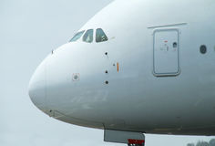 Nose of big airliner. Nose of very big, wide-body airliner on the ground Stock Photography