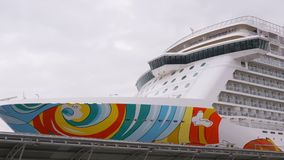 Nose of big cruise ship is moored in sea port in daytime stock footage