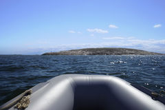 The nose of the boat, the sea and the island. View from the boat on the sea and the island Royalty Free Stock Photo