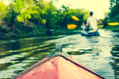 Nose of canoe floating behind rower Royalty Free Stock Photography