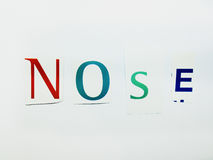 Nose - Cutout Words Collage Of Mixed Magazine Letters with White Background. Caption composed with letters torn from magazines with White Background Royalty Free Stock Photos