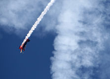 Nose Dive. A stunt airplane performs a inverted roll and nose dive at an airshow Stock Photography