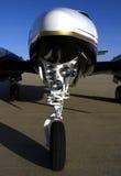 Nose gear. Closeup of an aircraft nose, lights, and landing gear Stock Image