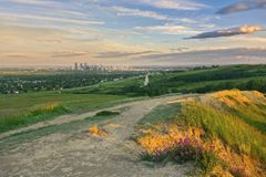 Nose Hill Urban Park Prairie Grassland Calgary Downtown City Center Dramatic Sunset Sky royalty free stock image