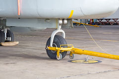 Nose landing gear and tow bar. Air aircraft airshow armed cabin Stock Images