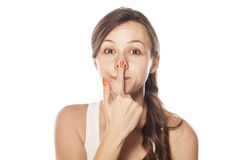 Nose lifting. Funny young woman lifting her nose with her finger Stock Images