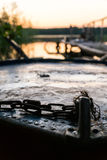 The nose of an old boat at sunset at the pier on the lake.  Royalty Free Stock Image