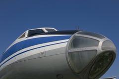 Nose of old jet plane. Cockpit of old jet plane TU-134A on blue sky background Stock Images