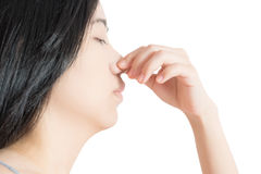 Nose pain symptom in a woman isolated on white background. Clipping path on white background. Stock Photos