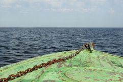 Nose part old iron boat on sea background. Horizon. Blue sky and clouds Stock Images