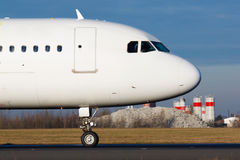 Nose of plane. Detail of white plane nose during taxi on taxiway Stock Photos