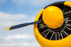 Nose and propeller of T-6 Airplane WarBird. Propeller cone and engine of T-6 aircraft with yellow paint and propeller stock photography