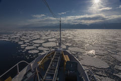 Nose of ship and view to icebergs Royalty Free Stock Image