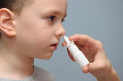 Nose spray for children Royalty Free Stock Photos