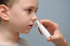Nose spray for children Royalty Free Stock Photos