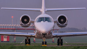 Nose view of Cessna Sovereign aircraft at the airport ramp Stock Images