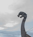 Nose Viking warship at a shadow in the background of cloudy sky Royalty Free Stock Images