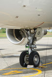 Nose wheel of commercial airliner. Detail of the nose wheel of the landing gear of a commercial airliner or airplane parked on the tarmac of an airport Royalty Free Stock Photography