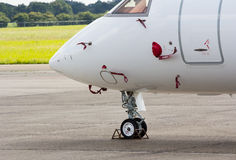 Nose wheel of a jet aircraft. Nose wheel of a parked jet aircraft royalty free stock photo