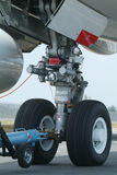Nose wheel of wide-body airplane. Nose wheel (front landing gear) of very large, wide-body airplane being towed at an airport Stock Images