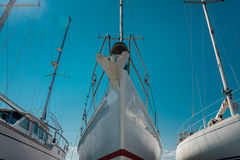 Nose of white sailboat in the port. Nose of white beautiful moored sailboat in the sea port Royalty Free Stock Images