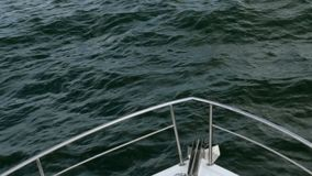 Nose of white sea ship or yacht, that cuts through the waves of the Black sea. stock video footage