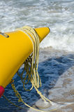 Nose yellow inflatable boat on the sea shore. Close-up, sunlight Royalty Free Stock Photography