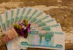 Nosegay. Bouquet of flowers wrapped in a dollar bill stock photo