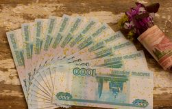 Nosegay. Bouquet of flowers wrapped in a dollar bill royalty free stock photos