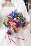 Nosegay in hands of bride. Bride is holding a large bright wedding bouquet royalty free stock photo