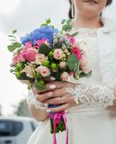Nosegay in hands of bride. Bride is holding a large bright wedding bouquet stock photos