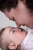 Noses touch. A mother with her baby girl. The noses touch each other so that is becomes a tender moment Stock Photography