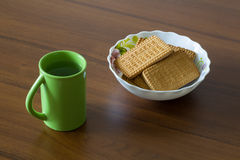 Nosh Light. Water and cookies. Royalty Free Stock Photo