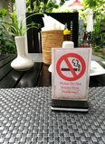 Nosmoking on the tablet dining room. No, smoking, sign, table, smoke, restaurant, health, warning, wood, cigarette, cafe, law, room, public, information, symbol stock photos