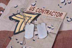 Nosotros uniforme del contratista con la placa de identificación Fotografía de archivo