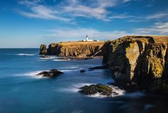 Noss Head lighthouse, Highlands shores of Northern Sea. Scotland royalty free stock photography