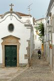 Nossa Senhora da Piedade Church, located along a typical cobbled narrow street inside the old town of Tavira, Algarve stock images