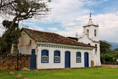 Nossa Senhora das Dores Church Paraty. The single tower church of Nossa Senhora das Dores and a typical colonial building in the city of Paraty, Rio de Janeiro Royalty Free Stock Photos