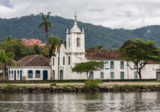 Nossa Senhora das Dores Church Paraty. The single tower church of Nossa Senhora das Dores and a typical colonial building in the city of Paraty, Rio de Janeiro Royalty Free Stock Photography