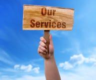 Nosso sinal de madeira dos serviços imagem de stock royalty free