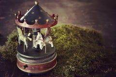 Nostalgi för vintege för hästar för karusell för jul för musikask royaltyfri fotografi