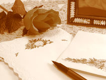 Nostalgia. Nostalgic still life in sepia tones (rose is fabric and has some texture Stock Photos