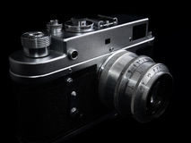Nostalgia, art and photography. Vintage silver camera, and dark background royalty free stock image
