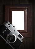 Nostalgia, art and photography. Vintage silver camera, and isolated wooden border stock photo