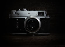 Nostalgia, art and photography. Vintage silver camera on wooden background royalty free stock image